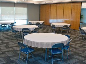 Multi-purpose room with covered round tables
